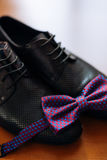 Men`s shoes and bow tie. Wedding accessories. And groom clothes Royalty Free Stock Photos