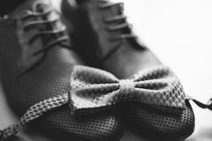 Men`s shoes and bow tie. Wedding accessories. And groom clothes Royalty Free Stock Images