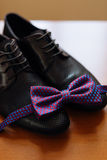 Men`s shoes and bow tie. Wedding accessories. And groom clothes Royalty Free Stock Photo
