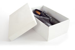 Men's Shoes in Box. A pair of men's shoes in a white box with copy space on the box on a white background Royalty Free Stock Photos