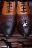 Men's  shoes and cufflinks Royalty Free Stock Photo