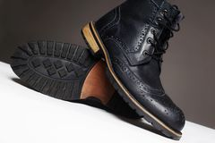 Men`s shoes.fashion still life. men black boots royalty free stock photography