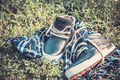 Men's shoes on the grass wrapped in a scarf Royalty Free Stock Photos