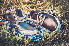 Men's shoes on the grass wrapped in a scarf Stock Image