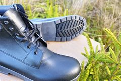 Men`s shoes with high side. Suitable for any weather and all seasons. Dirt, slush, snow, rocks and normal - on any surface will be. Men`s shoes with high side stock photography