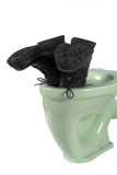Men's shoes and light green toilet (isolated) Royalty Free Stock Photography