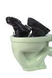 Men's shoes and light green toilet (isolated Royalty Free Stock Images