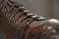 Men's shoes made from crocodile leather laces Stock Photography
