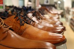 Men`s shoes on the shelf royalty free stock photo