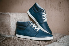 Men's shoes, sneakers on nature Stock Photos
