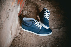 Men's shoes, sneakers on nature Stock Photo