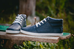 Men's shoes, sneakers on nature Royalty Free Stock Photos