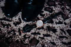 Men's shoes and watches Stock Image