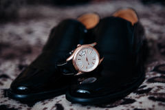 Men's shoes and watches. Stylish men's watches and black dress shoes Stock Photography