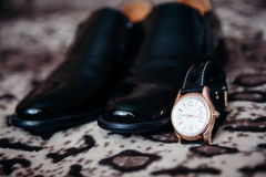Men's shoes and watches Stock Photo