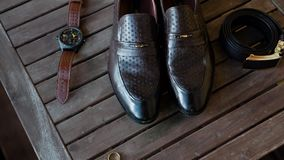 Men`s shoes, wedding rings, belt and toilet water. Composition. Men`s accessories close-up stock footage