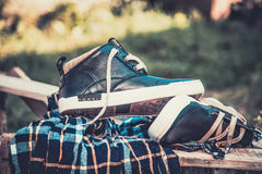 Men's shoes, wrapped in a scarf on a wooden ladder Royalty Free Stock Image
