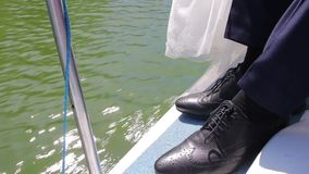 Men's shoes on yacht stock footage