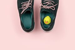 Men`s shoes with yellow duck. Abstract pastel color Men`s shoes with yellow duck on pink. Pranks and tricks concept for April fool`s day stock photography