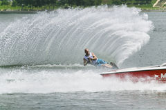 Men's Slalom Action - Jodi Fisher. Image of Jodi Fisher of Great Britain competing in the Men's Slalom Finals event at the 2009 Putrajaya Waterski World Cup Royalty Free Stock Image