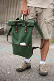 Men`s sneakers and backpack in the hand Stock Photo