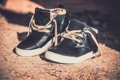 Men's sneakers in the dust on the asphalt Stock Image
