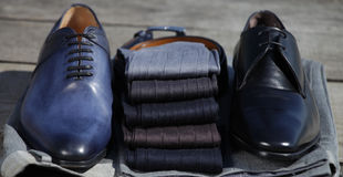 Men`s socks with shoes. Men`s socks on their feet, shoes with a selection of socks royalty free stock photography