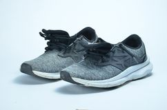 Men`s sport shoes. Pair of sport shoes, grey color sport shoes royalty free stock images