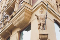 Men`s statues in full growth on the facade of a beautiful old house in Prague. stock images