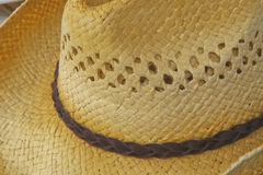 Men's Straw Hat. A close up of a straw hat showing it's texture and pattern and dark brown hat band Stock Image