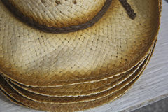 Men's Straw Summer Hat. A pile of men's straw summer hats. They are made from a woven material into a pattern and texture Royalty Free Stock Photography