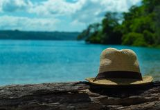 Men`s hat is a log to the left. Beautiful seascape royalty free stock photos
