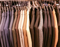 Men's suit coats on a rack Stock Image