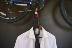 Men& x27;s suit hanging on a hanger. Men& x27;s white shirt and tie hang on a hanger royalty free stock images