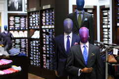 Men`s suit store display. Display of interesting mannequins in a men`s clothing store royalty free stock photos