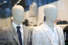 Men`s suit store display stock images