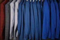 Men`s suits on a hanger Stock Photos
