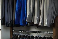 Men`s suits on a hanger Stock Photo