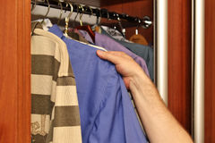 Men`s summer clothes. In the closet Royalty Free Stock Photo
