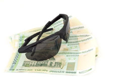 Men's sunglasses and Belarusian money Stock Images