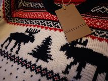 Men`s sweater with deer. Warm and beautiful sweater with drawings of deer. Details and close-up stock image