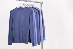 Men`s sweaters on hanger Stock Photography