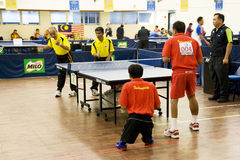 Men's Table Tennis for Disabled Persons. Image of the men's doubles table tennis for disabled persons match between Malaysia (yellow) and Indonesia (red) at the Stock Photography