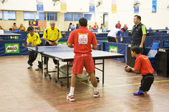 Men's Table Tennis for Disabled Persons. Image of the men's doubles table tennis for disabled persons match between Malaysia (yellow) and Indonesia (red) at the Royalty Free Stock Image