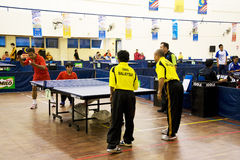 Men's Table Tennis for Disabled Persons. Image of the men's doubles table tennis for disabled persons match between Malaysia (yellow) and Indonesia (red) at the Stock Image
