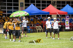 Men's Team Archery Action Stock Image