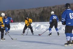 Men`s teams compete in a Pond Hockey Festival in Rangeley. Stock Photography