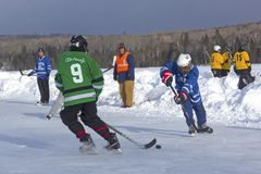 Men`s teams compete in a Pond Hockey Festival in Rangeley. Stock Photo