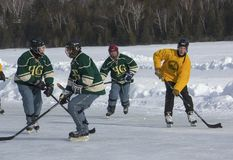 Men`s teams compete in a Pond Hockey Festival in Rangeley. Stock Images