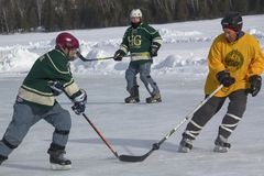 Men`s teams compete in a Pond Hockey Festival in Rangeley. Stock Photos